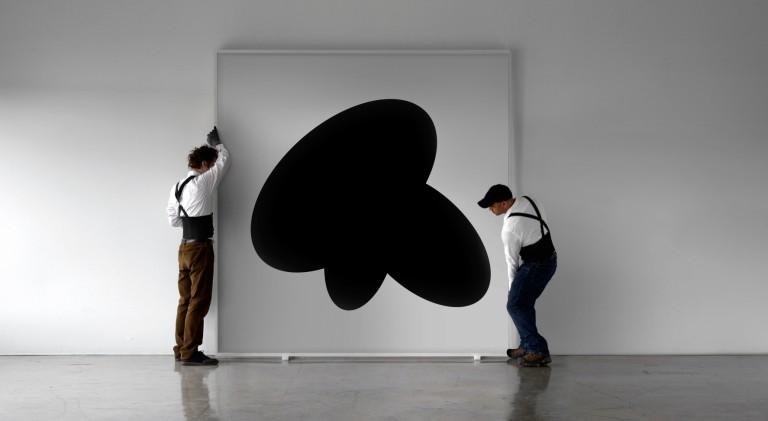 Art Handlers Installing Large Piece of Art