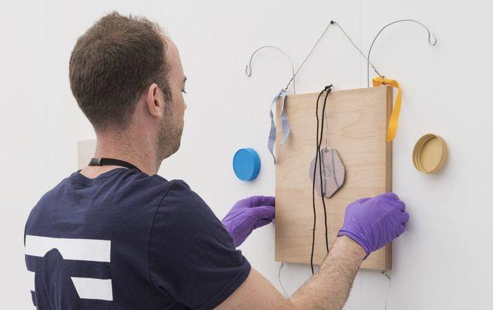 A UOVO art handler installing at Frieze New York 2018.