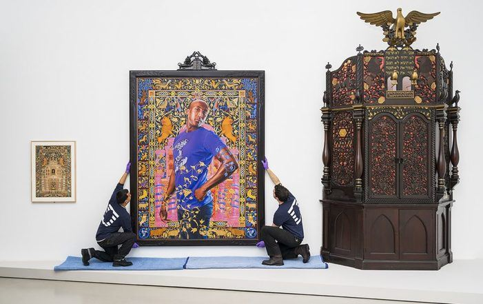 UOVO art handlers installing Kehinde Wiley painting at the Jewish Museum, New York