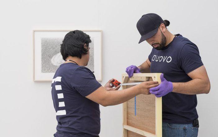 UOVO art handlers installing at Frieze New York 2018.
