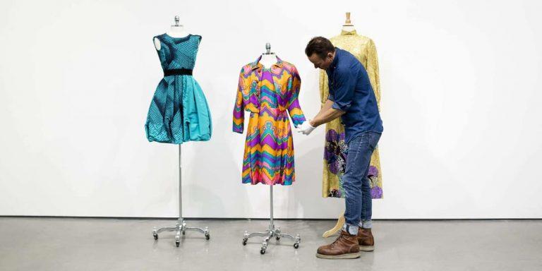 UOVO Art Handler Prepares Designer Dresses for Viewing