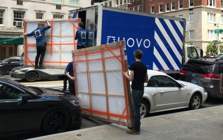 UOVO art handlers de-installing a gallery exhibition
