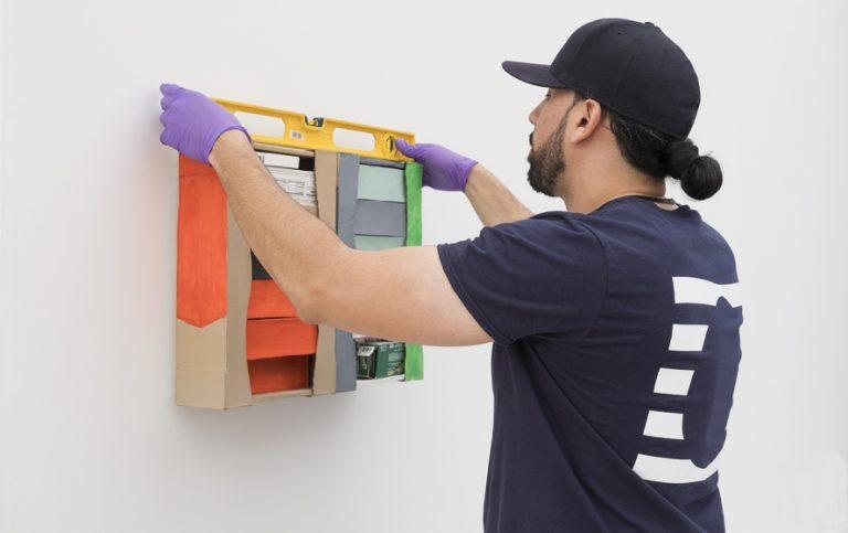 A UOVO art handler installing at Frieze art fair, New York, 2018.